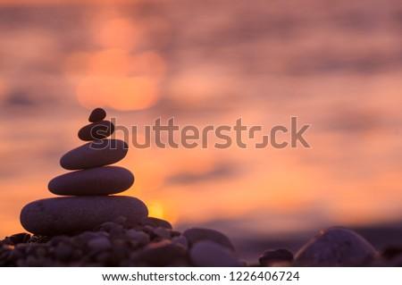 stack of zen stones on pebble beach #1226406724