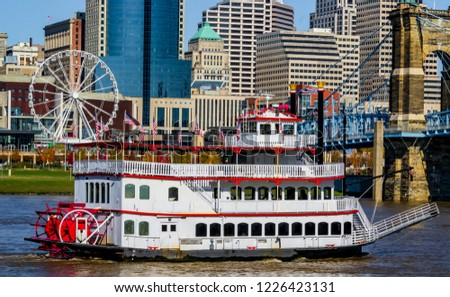 Colorful Cincinnati river front looking from Kentucky with steam boat and Farris wheel. Urban exploration photography 2018 #1226423131