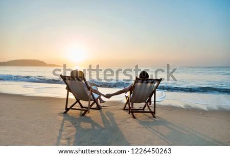 Couple sunbathing on a beach chair. #1226450263