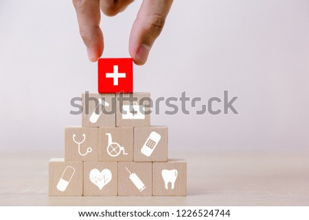 Health Insurance Concept,hand arranging wood block stacking with icon healthcare medical. #1226524744