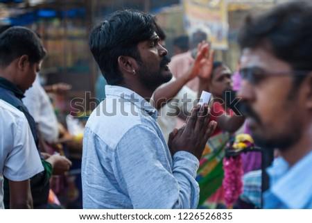 Tiruvannamalai in Tamil Nadu, India, January 31, 2018: People praying in front of the Tiruvannamalai temple #1226526835