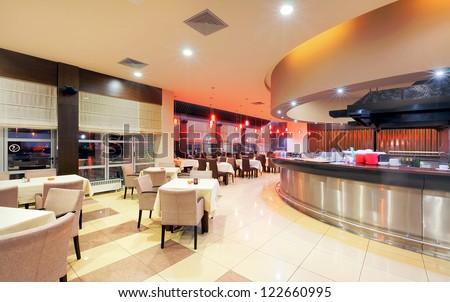 Modern restaurant interior, part of a hotel, night scene. #122660995