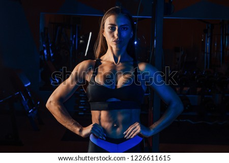 cute girl is engaged in the gym.young woman making exercise at the gym #1226611615