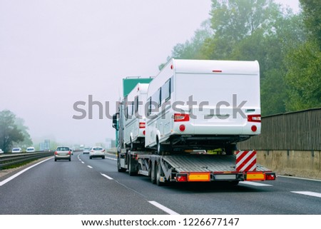 Truck carrier with motor homes rv on the asphalt road of Slovenia. #1226677147