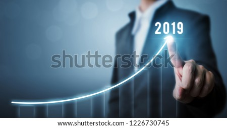Business development to success in 2019 concept. Businessman pointing arrow graph corporate future growth plan Royalty-Free Stock Photo #1226730745