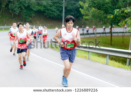 Chiang Rai THAILAND-9:29:2018: MFU RUN 2018 in Mae Fah Luang University Chiang Rai Thailand.People. Running at city streets. #1226889226