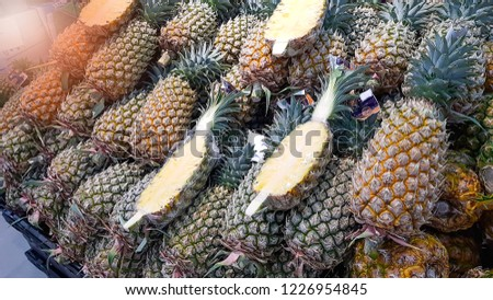 Many pineapples in the store are for sale to customers. #1226954845