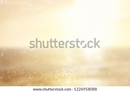 glitter vintage lights background. silver and gold. de-focused