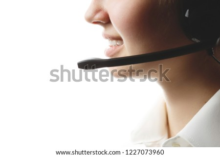 call center worker close-up on an isolated white background, young girl with headphones and microphone, online technical assistance #1227073960