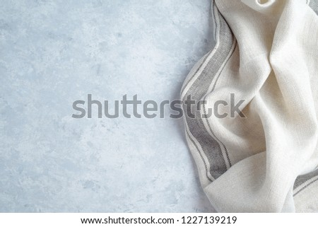 kitchen cloth napkin on wood background with copy space