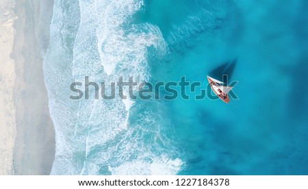 Yacht on the water surface from top view. Turquoise water background from top view. Summer seascape from air. Travel concept and idea #1227184378