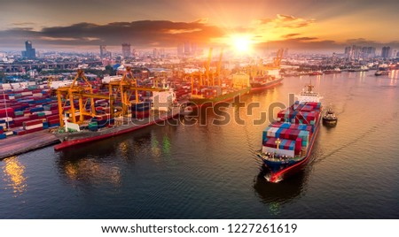 Logistics and transportation of Container Cargo ship and Cargo plane with working crane bridge in shipyard at sunrise, logistic import export and transport industry background #1227261619