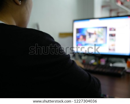 blurred of business woman using computer and work at the office. #1227304036