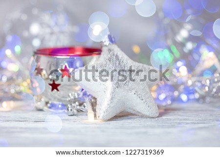 christmas tree decorations against blurred glowing lights background. winter holidays decorations #1227319369