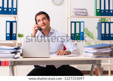 Young employee sitting at the office  #1227333097