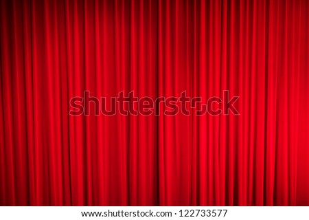 Red closed curtain with light spots in a theater Royalty-Free Stock Photo #122733577