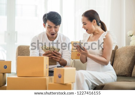Happy couple at Home office with Online business, Marketing online and freelance job #1227416155