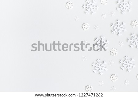 Christmas composition. Christmas frame made of snowflakes on pastel gray background. Winter concept. Flat lay, top view, copy space #1227471262