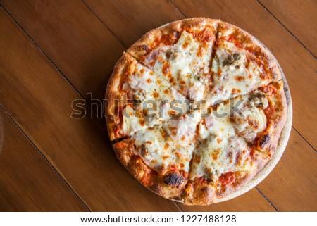 Hawaiian pizza on wooden background #1227488128