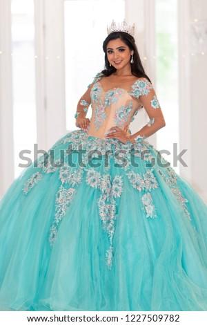 Young teen hispanic girl wearing a quinceanera dress