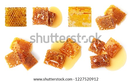 Set with sweet honeycomb pieces on white background, top view Royalty-Free Stock Photo #1227520912