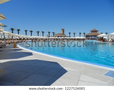 Swimming pool and sun loungers at the resort #1227526081