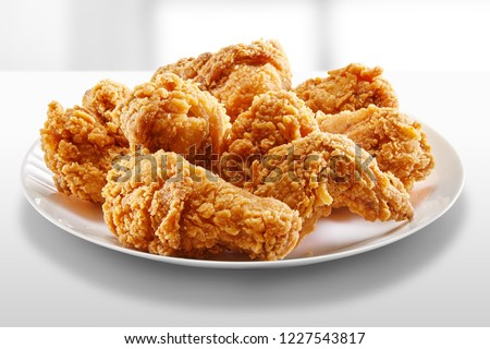 crispy fried chicken in a white table #1227543817