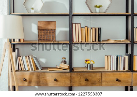 close up of wooden rack with books in living room  #1227558307