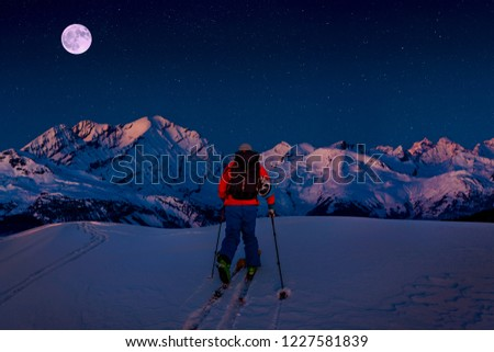 Night ski with amazing view of swiss famous mountains in beautiful winter snow. The skituring, backcountry skiing in fresh powder snow. #1227581839