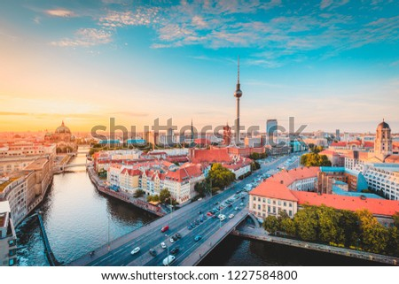 Classic view of Berlin skyline with famous TV tower and Spree in beautiful golden evening light at sunset, central Berlin Mitte, Germany #1227584800