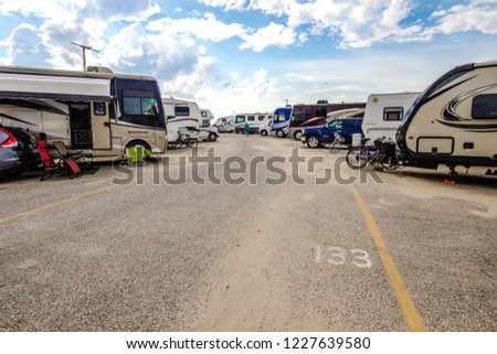Grand Haven, Michigan, USA - September 18, 2018: Summer campers fill the camp sites at Grand Haven State Park on the shores of Lake Michigan.  #1227639580