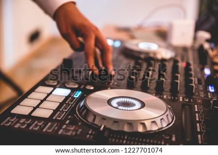 DJ mixer, DJ mix music on the console, the DJ's hand #1227701074