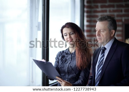 closeup.business woman and investor standing in the office #1227738943