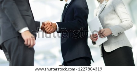 Business handshake and business people. #1227804319