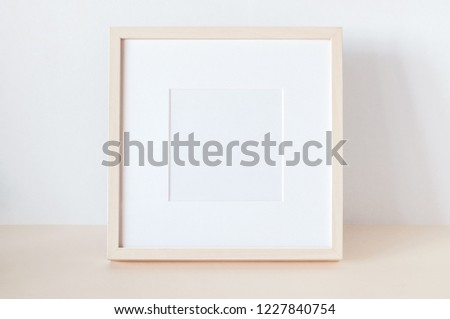 Wooden Square Frame with Poster Mockup.