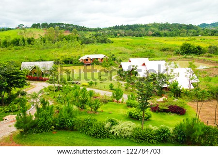 View from above of a village and green grass in thailand #122784703