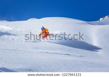 freeride skiing in powder snow #1227861121