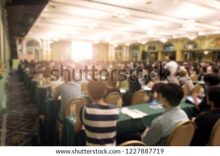 Abstract blurred photo of conference hall or seminar room with attendee background.  Bokeh business meeting conference training learning coaching #1227887719