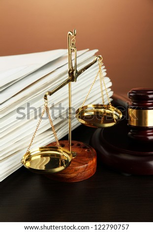 Golden scales of justice, gavel and folders on brown background #122790757