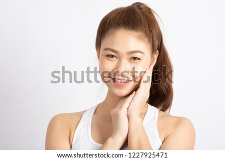 Beautiful Attractive Charming Asian young woman smile with white teeth and touching soft cheek feeling so happy and cheerful with healthy skin,isolated on white background,Beauty Cosmetology Concept
