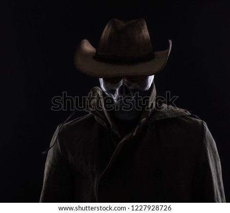evil man in a scary mask on a black background