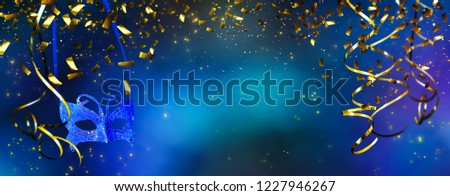 beautiful carnival decoration background, frame of golden party streamers and carnival mask at abstract  magic blue night  #1227946267