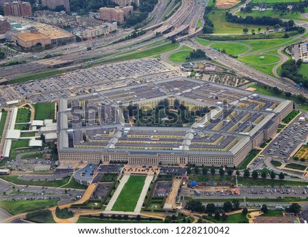 Aerial view of the United States Pentagon, the Department of Defense headquarters in Arlington, Virginia, near Washington DC, with I-395 freeway and the Air Force Memorial and Arlington Cemetery nearb #1228210042