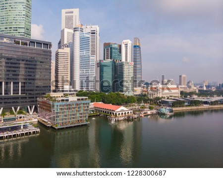 Singapore - October 10, 2018 : Aerial view of Singapore city skyline on Sunny morning day. #1228300687