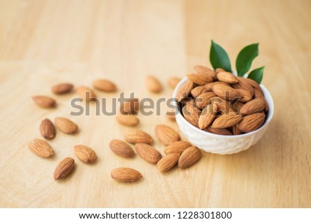 almond on wooden table. soft focus. #1228301800