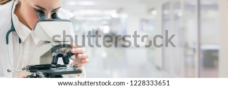 Scientist researcher using microscope in laboratory. Medical healthcare technology and pharmaceutical research and development concept. #1228333651