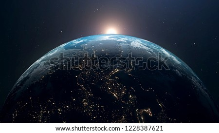 Planet Earth and sun. The sun is rising over World shading atmosphere, shading night to day 3D rendering. #1228387621
