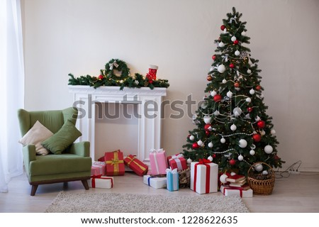 Christmas tree with Garland decoration and gifts for the new year