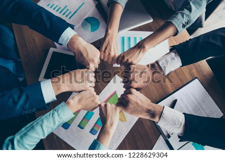 Cropped top above high angle view photo of hands holding fists in round circle stylish elegant classy business sharks over table desk paper documents gathering work station place #1228629304