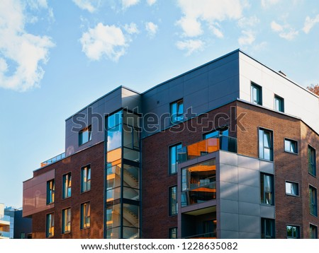 Facade of contemporary luxury building exterior concept. Residential house and home. #1228635082